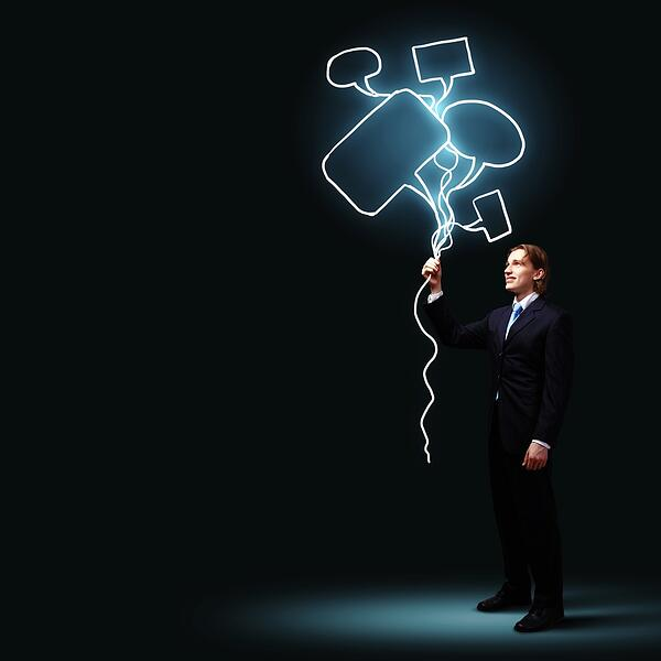 Image of businessman in black suit against dark background